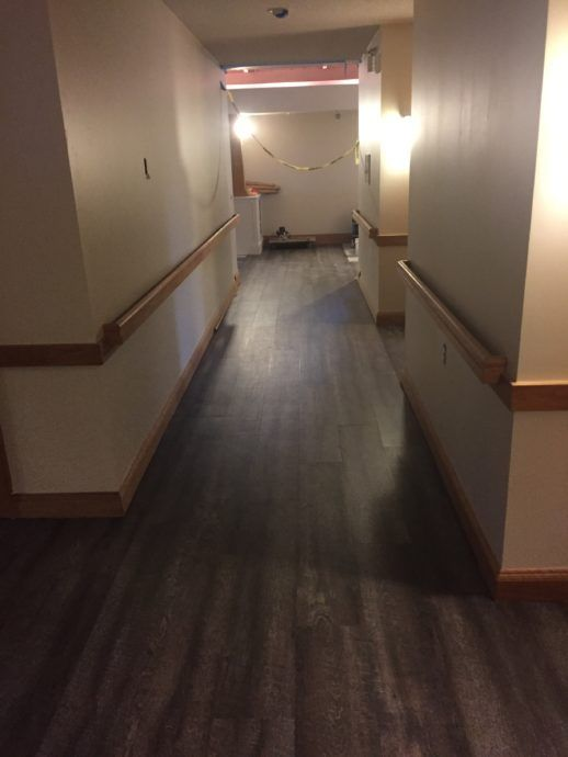 The hallway has its new floor–now just needs some new lighting!