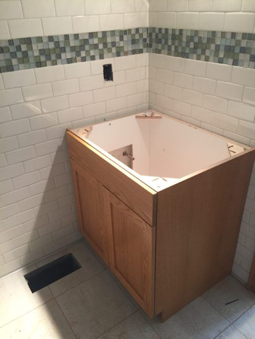 The new vanity in the family suite bathroom just needs a countertop and sink!