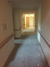 The hallway is ready for new floors, new lighting, and a pop of color!